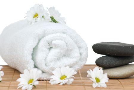 Chamomile flowers and seashell on bamboo isolated on white background Stock Photo - 6651265