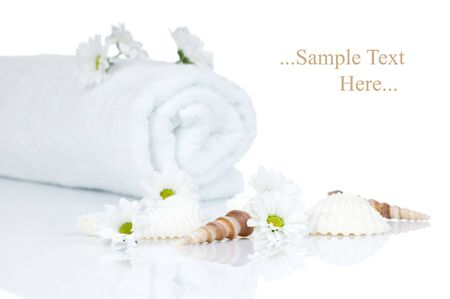 Towel and Chamomile flowers and seashell isolated on white background
