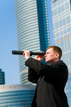 Businessman with telescope looking to the future Stock Photo