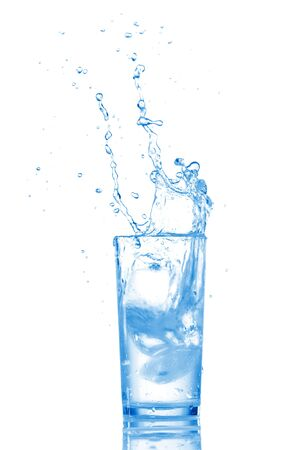 Water in glass isolated on white background photo