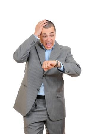 Knappe zaken man controle zijn pols-watch  Stockfoto