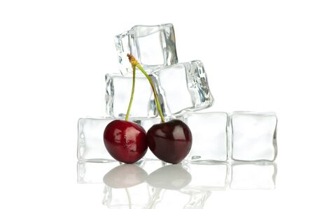 Cherry and ice cubes isolated on white background photo