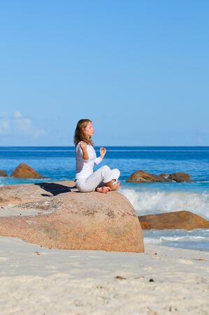 Young woman in lotus pose meditating Stock Photo - 17128326
