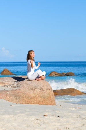 Young woman in lotus pose meditating Stock Photo - 17121049