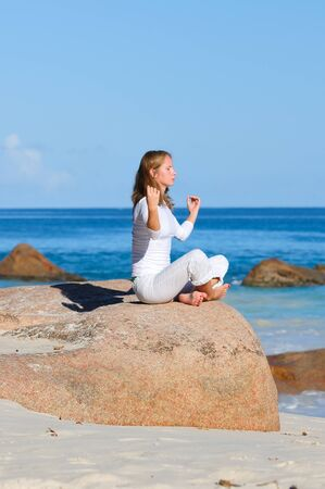 Young woman in lotus pose meditating Stock Photo - 17099039