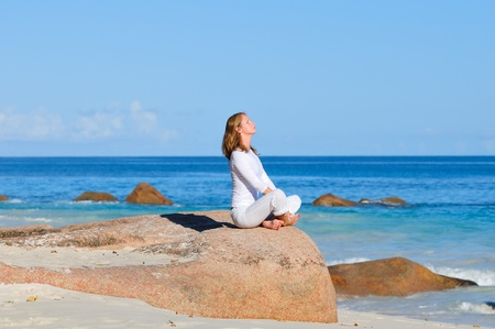 Young woman in lotus pose meditating Stock Photo - 17121072