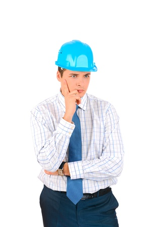 Businessman with blue hard hat standing confidently isolated on white background Stock Photo - 17099047
