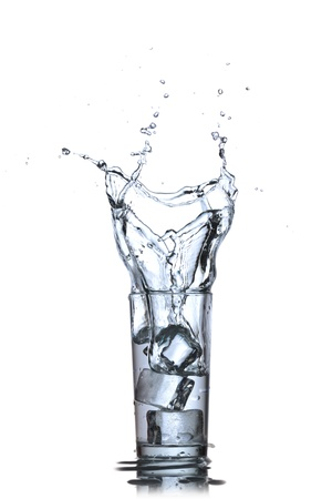 welling: Glass of water with ice cubes on white background  Water splash Stock Photo
