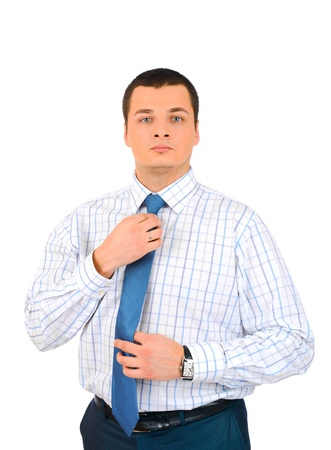 Portrait of a business man touching his tie, isolated on white background Stock Photo - 18157220