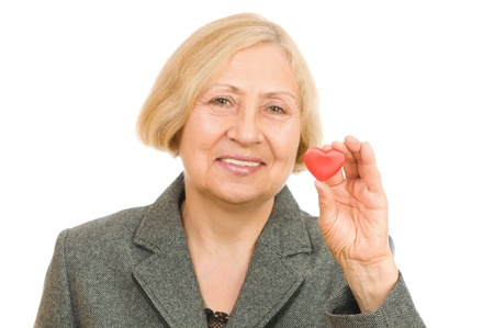 Senior woman holding red Heart isolated on white background photo