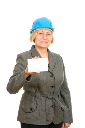 Senior woman with blue hard hat holding a blank isolated on white background photo