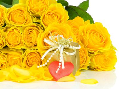 Yellow roses with heart isolated on white background photo