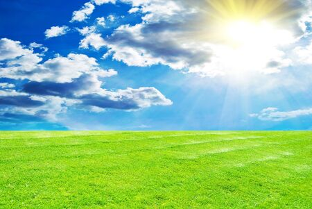 Blue sky and grass background photo