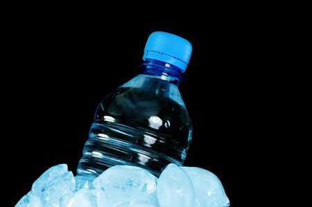 Bottled water isolated over a black background photo