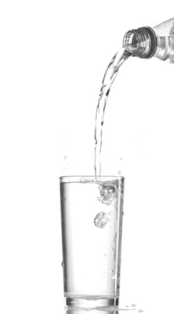 welling: Water in glass isolated on white background