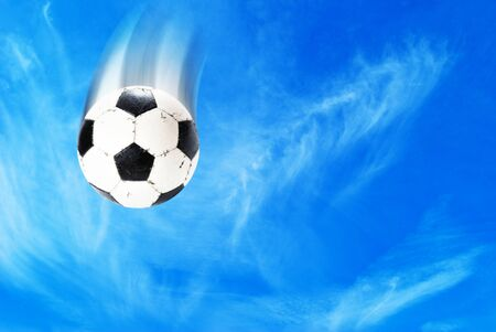 soccer ball on sky background photo
