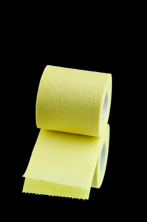 Toilet paper isolated on black background photo