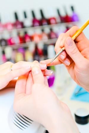 manicure nails: Manicure in process