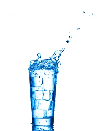 welling: Water in the glass isolated on white background