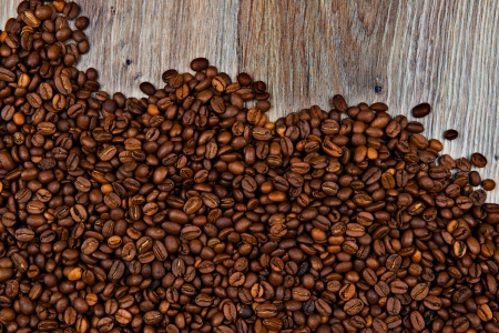 coffeetree: Coffee beans on grunge wooden background