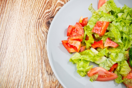 Organic vegetable salad on the wooden table photo
