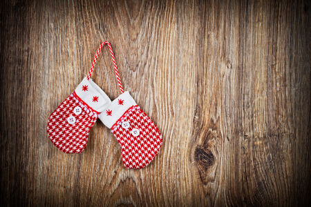 Christmas mittens on wooden background photo