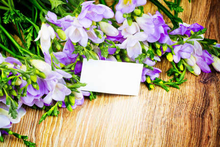 Freesia flowers with greeting card photo