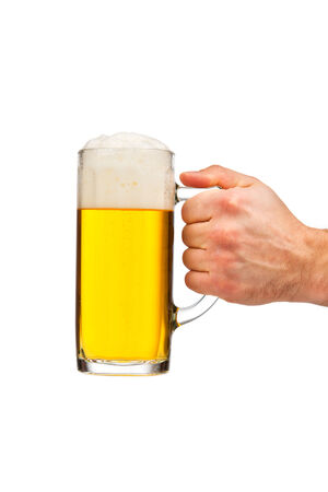 Glass of beer in a male hand photo