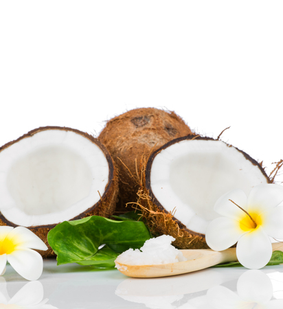 Coconut with green leaf and coconut oil on the wooden spoon photo