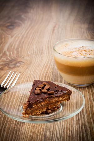 Cup of coffee latte with chocolate cake photo
