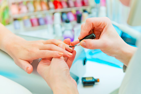 Manicure in process   Stock Photo