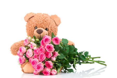funy: Bunch of roses and a teddy bear on white background