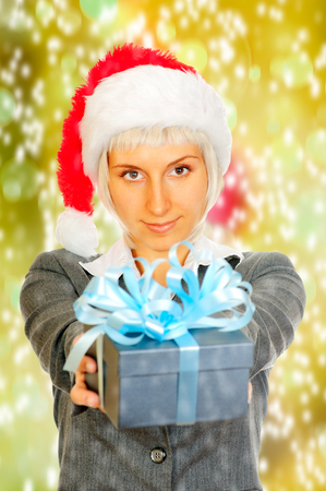 Young woman holds a giftbox in her hands photo
