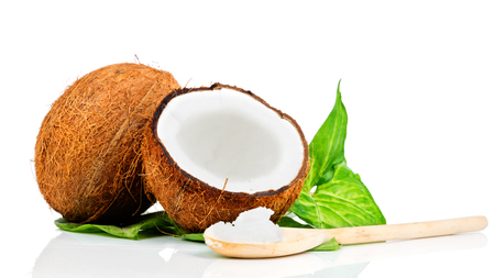 Coconut with green leaf and wooden spoon