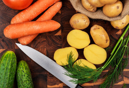 Raw vegetables on wooden background photo