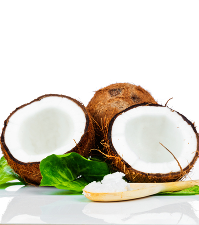 Coconut with green leaf and wooden spoon photo