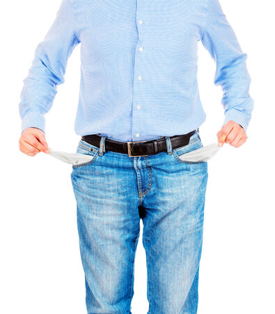 Man pulling out empty pockets photo