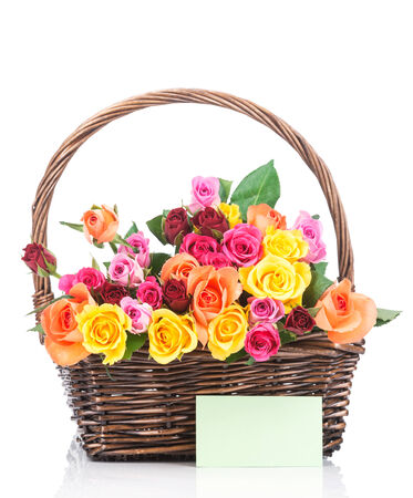 Roses in the basket on white background photo