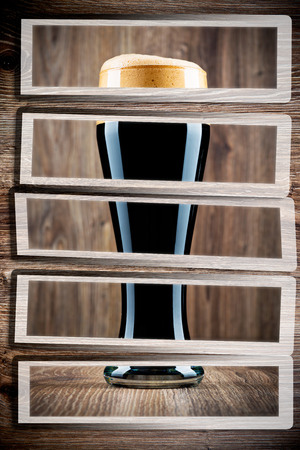 woodenrn: Glass of beer set on wooden background