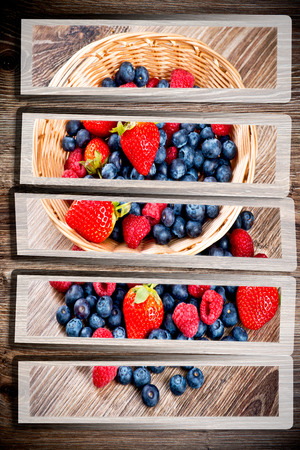 woodenrn: Berries on wooden background