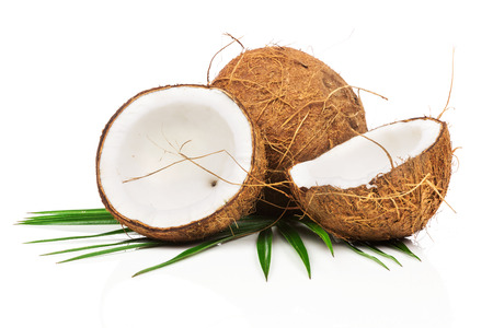 Coconut with green leaves on white background