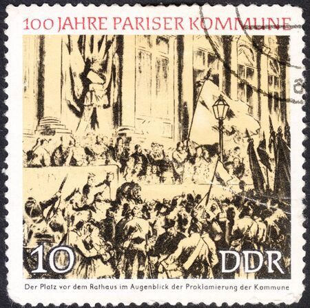 proclamation: MOSCOW, RUSSIA - CIRCA JANUARY, 2016: a post stamp printed in DDR shows Proclamation of the Commune, Town Hall, Paris, the series The 100th Anniversary of the Parisian Commune, circa 1971