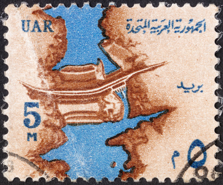 abjad: MOSCOW, RUSSIA - JANUARY, 2016: a post stamp printed in United Arab Republic (UAR) shows  the Nile River and Aswan High Dam  ,the series National Symbols, circa 1964