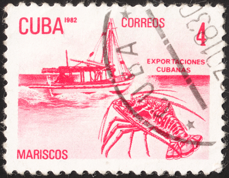 lobster boat: MOSCOW, RUSSIA - JANUARY, 2016: a post stamp printed in CUBA shows a boat and a lobster (Mariscos), the series Exports, circa 1982