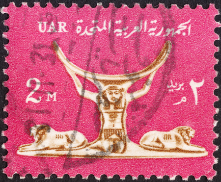 abjad: MOSCOW, RUSSIA - JANUARY, 2016: a post stamp printed in United Arab Republic (UAR) shows an Ivory headrest  ,the series National Symbols, circa 1964