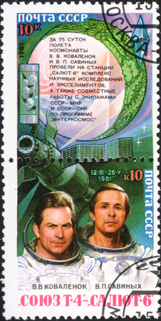 soyuz: MOSCOW, RUSSIA - DECEMBER, 2015: a post stamp printed in the USSR shows portraits of V. V. Kovalenok and V. P. Savinykh and devoted to Space Research on Complex Soyuz T-4 - Salyut-6, circa 1981