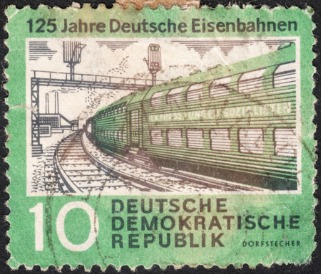 rail roads: MOSCOW, RUSSIA - CIRCA JANUARY, 2016: a post stamp printed in DDR shows a train, the series The 125th Anniversary of Rail Roads, circa 1960 Editorial