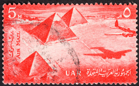 abjad: MOSCOW, RUSSIA - JANUARY, 2016: a post stamp printed in United Arab Republic (UAR) shows Pyramids and an airplane, the series Airmail, circa 1959 Editorial