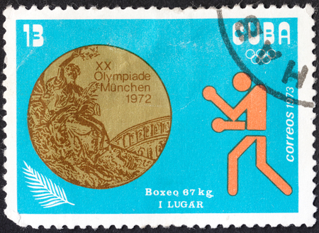knockdown: MOSCOW, RUSSIA - CIRCA JANUARY, 2016: a post stamp printed in CUBA shows a Golden medal in boxing, the series Cuban Medals in Olympic Games - Munich 1972, Germany, circa 1973