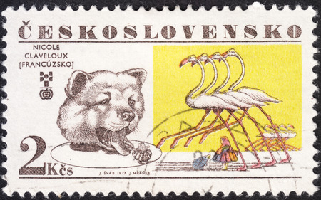 lewis carroll: MOSCOW, RUSSIA - JANUARY, 2016: a post stamp printed in CZECHOSLOVAKIA shows a Bear and flamingos, the series The 6th Biennial Exhibition of Childrens Book Illustrators, Bratislava, circa 1977 Editorial
